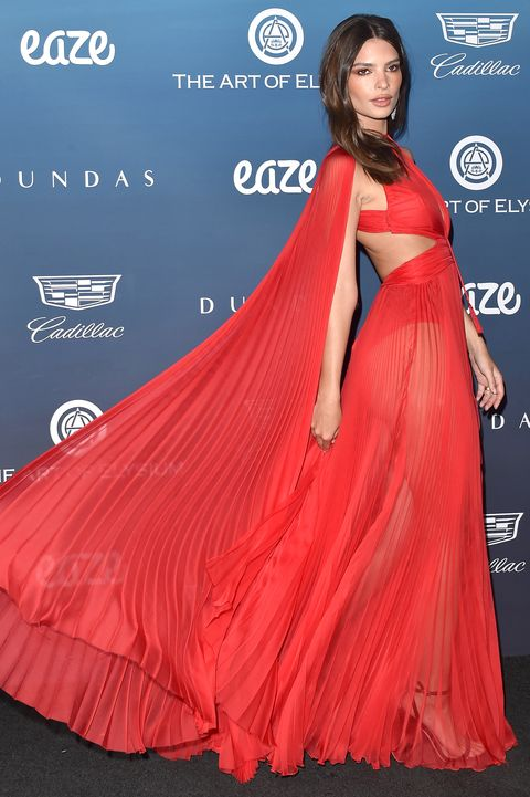 Emily Ratajkowski in a red dress at the Art of Elysium Gala