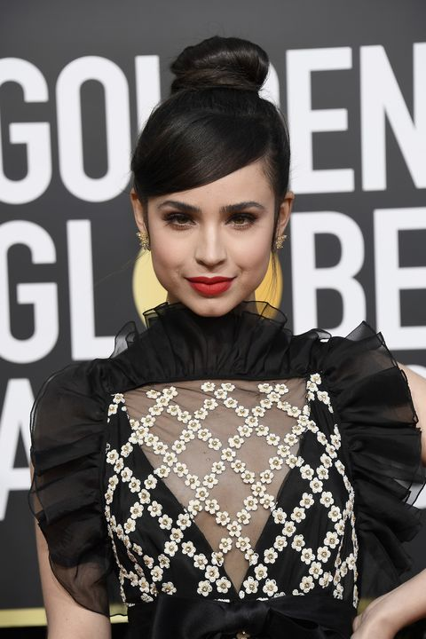 Sofia Carson Carries Time S Up Ribbon On Golden Globes Red