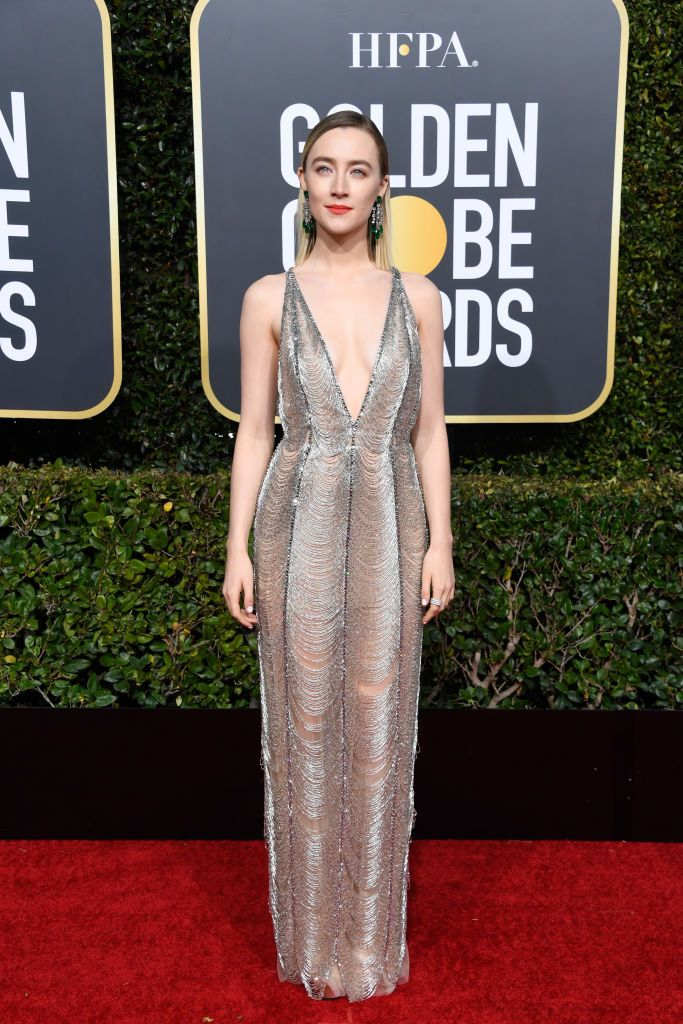 Saoirse Ronan Ronan wore this custom Gucci dress to the Golden Globe Awards. The plunging neckline gown was made of delicate silver threads that draped over her frame and showed just a bit of skin here and there when she walked.