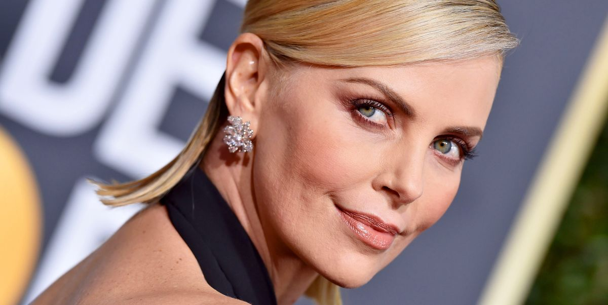 Charlize Theron At The Oscars Looks Like A Whole New Woman