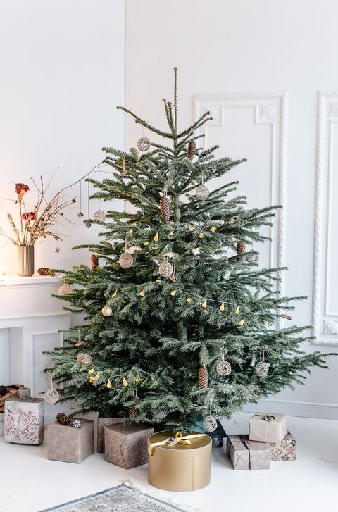 minimal scandinavian decorated christmas tree with presents boxing day 2018