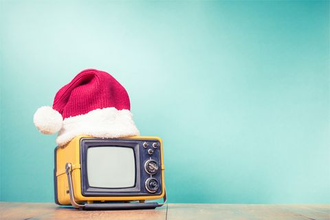 retro tv in santa hat front mint green background holidays congratulation in mass media concept vintage old style filtered photo