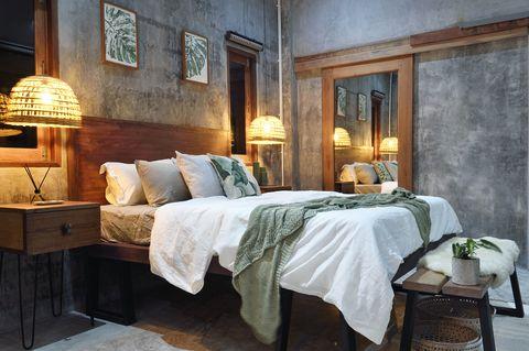 Luxury concrete bedroom at night