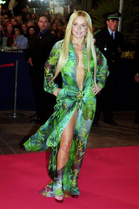 Red carpet, Carpet, Clothing, Flooring, Fashion, Premiere, Event, Dress, Long hair, Leg,