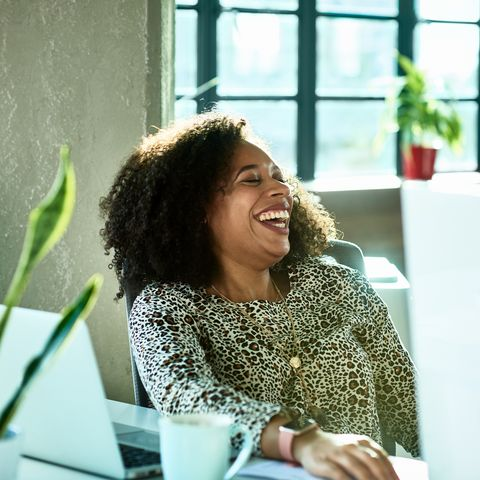 Candid portrait of mixed race professional woman laughing