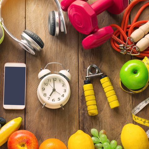 High Angle View Of Various Fruits With Exercise Equipment On Table