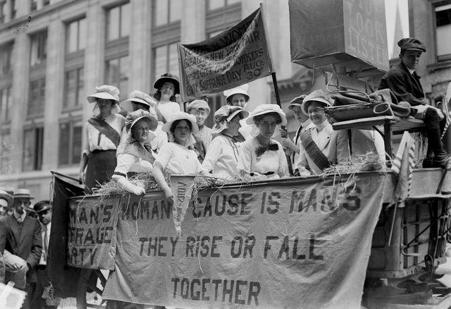 close up of a large group of suffragists as they ride in a hay wagon adorned with slogans, 1914 one slogan reads womans cause is mans they rise or fall together photo by bain news servicebuyenlargegetty images