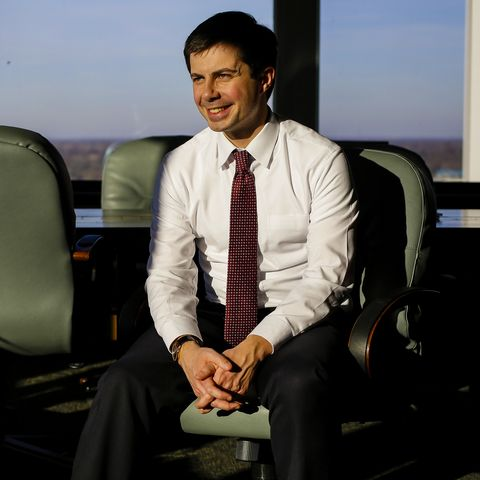 Sitting, Suit, White-collar worker, Photography, Businessperson, Flash photography, Formal wear,