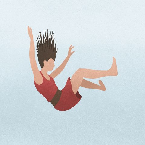 A woman falling against a blue background