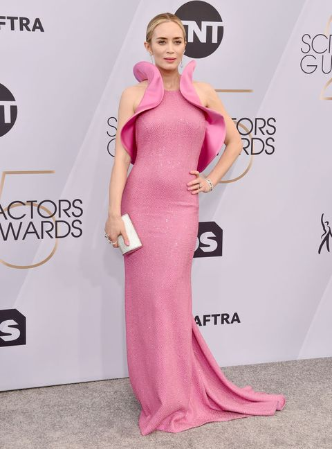 Dress, Clothing, Red carpet, Carpet, Shoulder, Pink, Fashion model, Gown, Hairstyle, Neck,