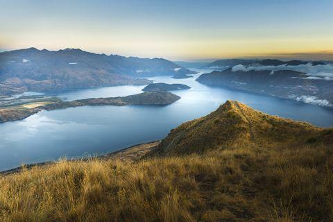 Highland, Sky, Mountainous landforms, Nature, Mountain, Hill, Atmospheric phenomenon, Wilderness, Mountain range, Fell,