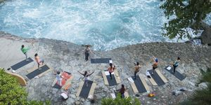 Mexico, Mismaloya, instructor with yoga class at ocean front