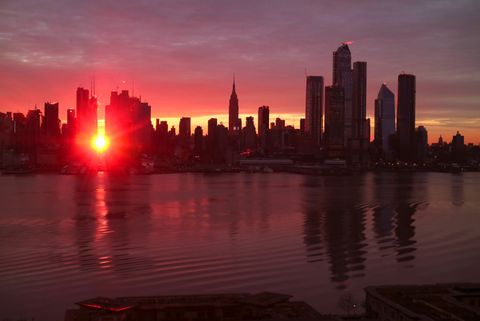 weehawken, nj   january 12 the sun rises down 42nd street during a manhattanhenge sunrise in new york city on january 12, 2018 as seen from weehawken, new jersey photo by gary hershorngetty images