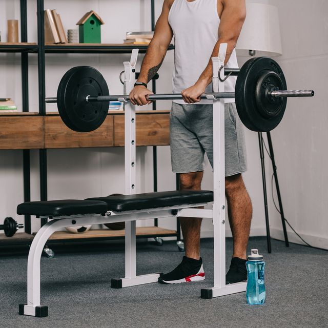 cropped view of man exercising in home gym