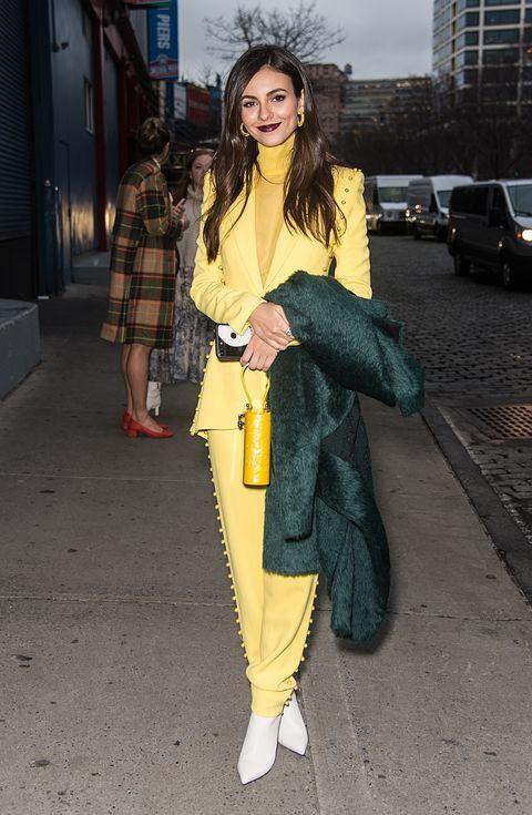 Clothing, Street fashion, Yellow, Fashion, Snapshot, Outerwear, Jeans, Footwear, Pantsuit, Leg,