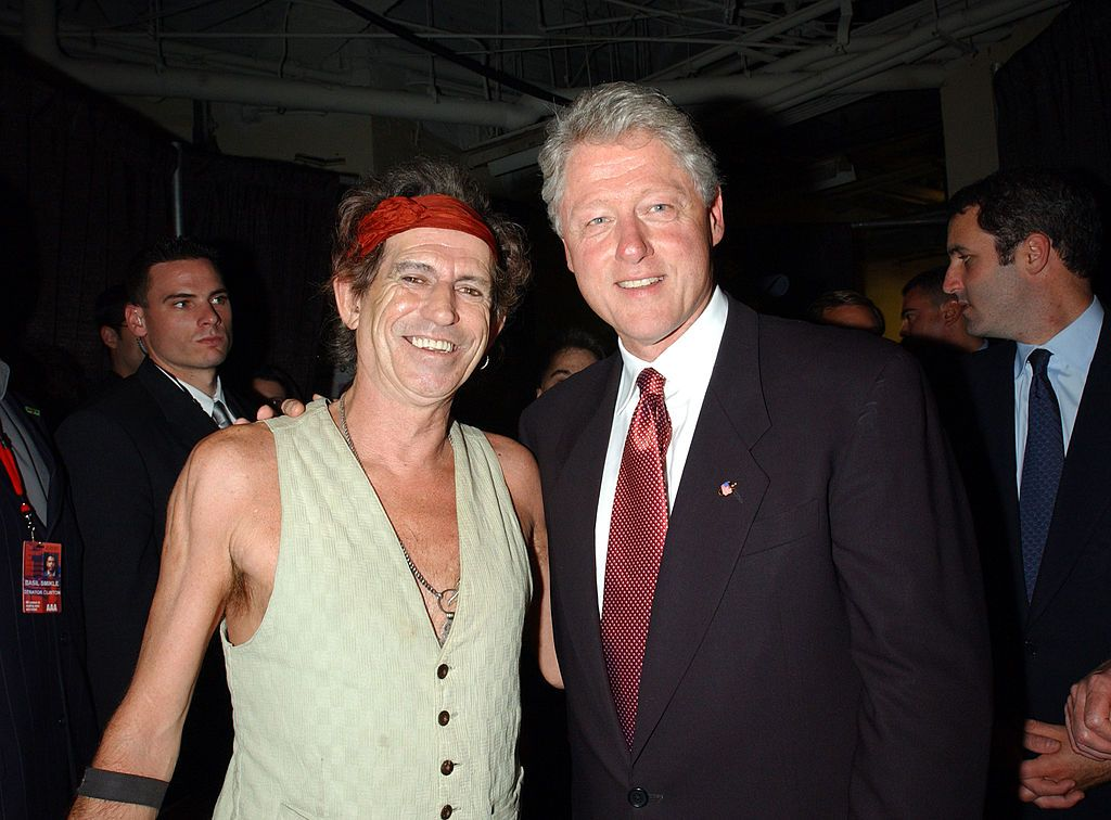 Keith Richards With Bill Clinton Only a rocker could meet a president in just a vest. Here, the Rolling Stones singer-songwriter poses with the former president backstage at the 2001 Concert for New York City, a benefit concert in response to the 9/11 terrorist attacks.