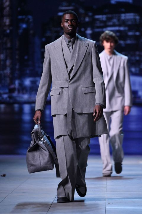 Suit, Fashion, Clothing, Formal wear, Fashion model, Runway, Fashion show, Outerwear, Human, Footwear,