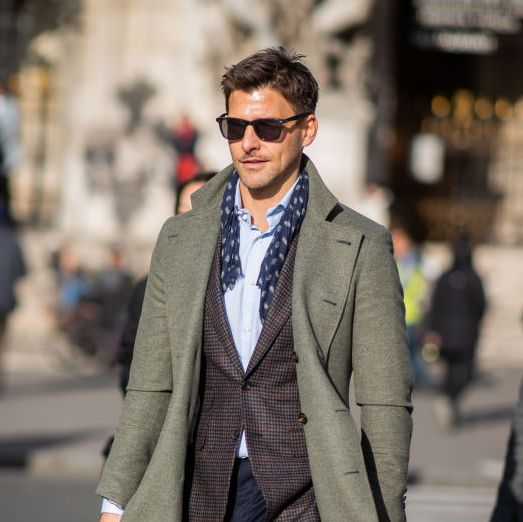 paris, france   january 18 johannes huebl is seen wearing olive coat, blazer, scarf, navy pants outside berluti during paris fashion week   menswear fw 2019 2020 day four on january 18, 2019 in paris, france photo by christian vieriggetty images