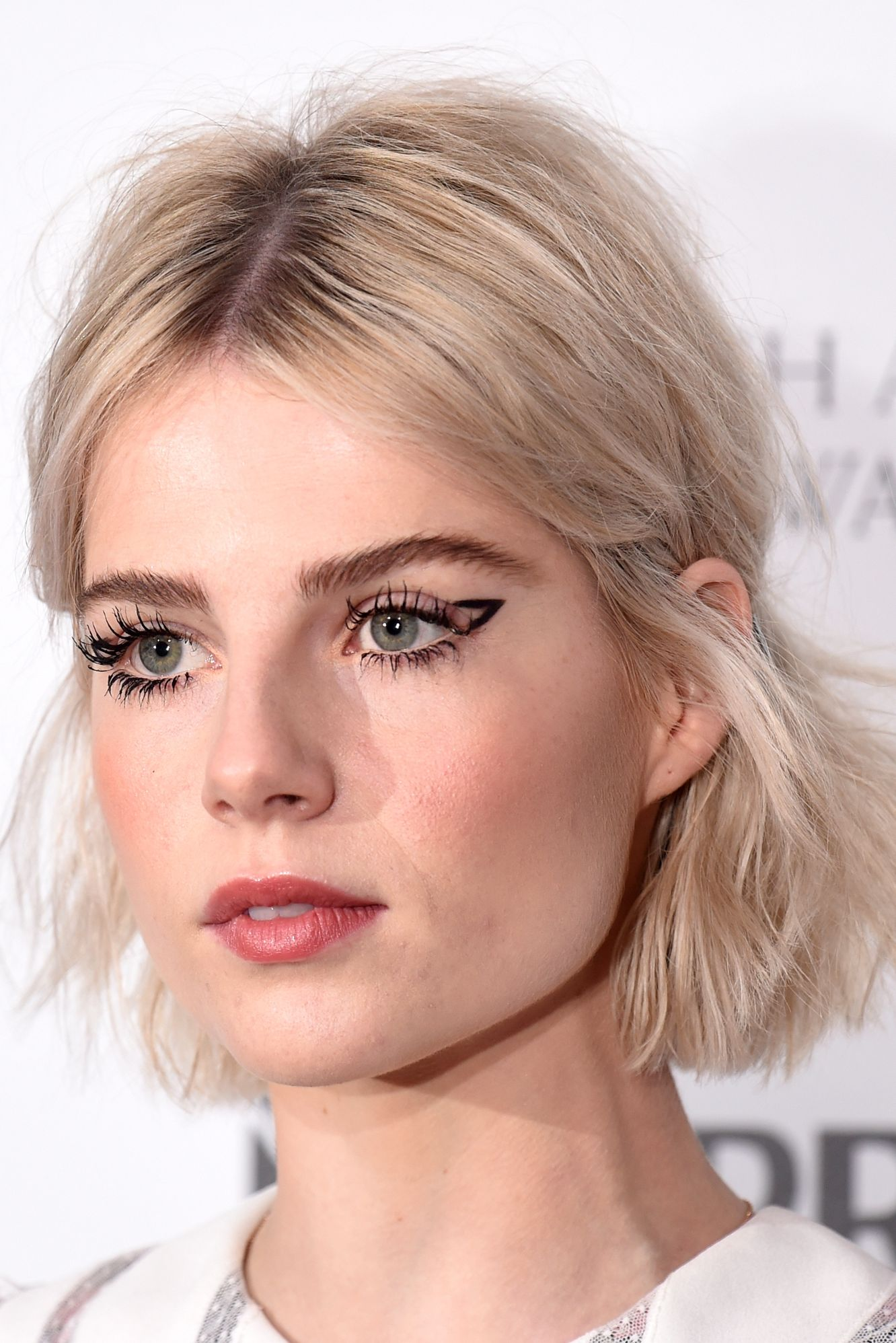Lucy Boynton Stop trying to smooth down your flyaways, and work with them instead. Everything about Lucy Boynton's graphic eyeliner, brushed-up brows, and choppy bob is a vibe.