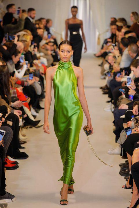 Fashion model, Fashion show, Fashion, Runway, Clothing, Fashion design, Shoulder, Event, Dress, Footwear,
