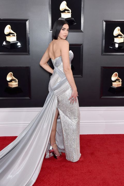 Red carpet, Dress, Carpet, Clothing, Fashion model, Gown, Flooring, Shoulder, Strapless dress, Fashion,