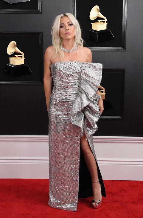 Red carpet, Carpet, Clothing, Dress, Shoulder, Flooring, Fashion model, Fashion, Cocktail dress, Premiere,
