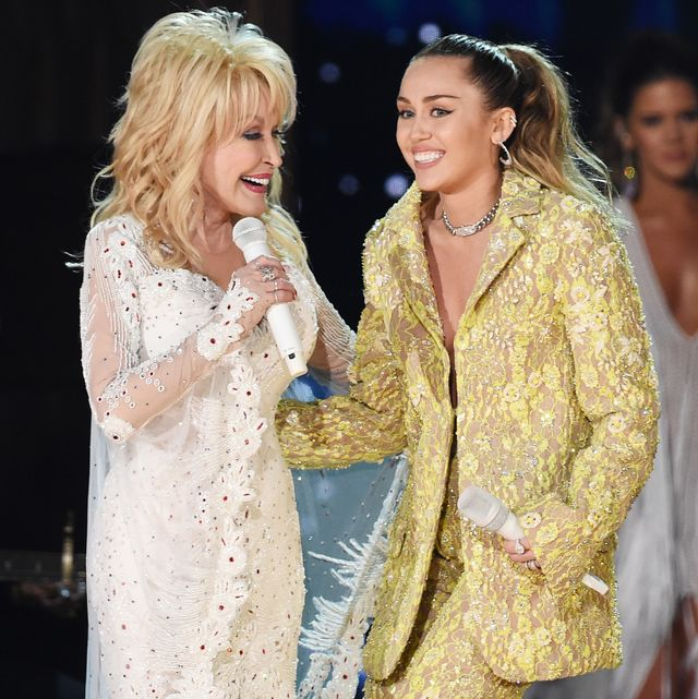 los angeles, ca   february 10  dolly parton l and miley cyrus perform onstage during the 61st annual grammy awards at staples center on february 10, 2019 in los angeles, california  photo by kevin wintergetty images for the recording academy