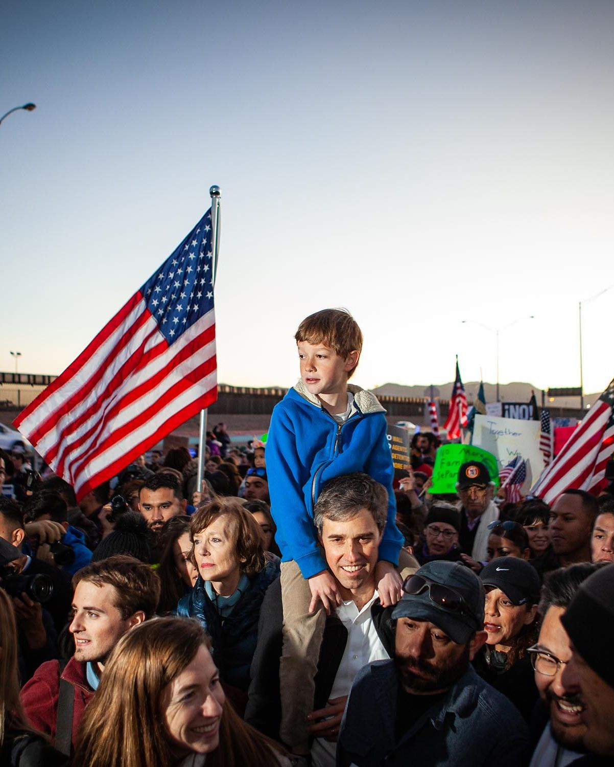 Beto O'Rourke carries his son Henry O'Rourke on his shoulder as they march along the US Mexico border in protest of President Donald Trump's proposed border wall, February 11, 2019 in El Paso, Texas.