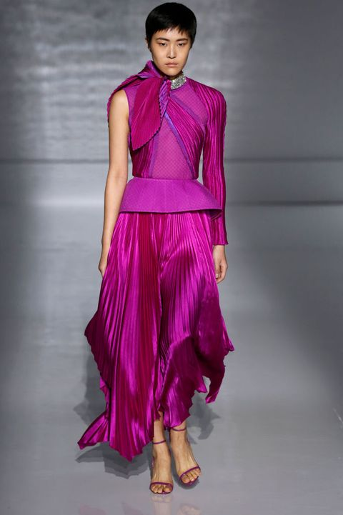 Fashion model, Fashion show, Fashion, Clothing, Runway, Dress, Magenta, Shoulder, Fashion design, Formal wear,