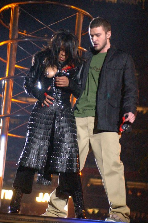 Entertainment, Outerwear, Performing arts, Coat, Jacket, Fashion, Performance, Pop music, Boot, Stage,