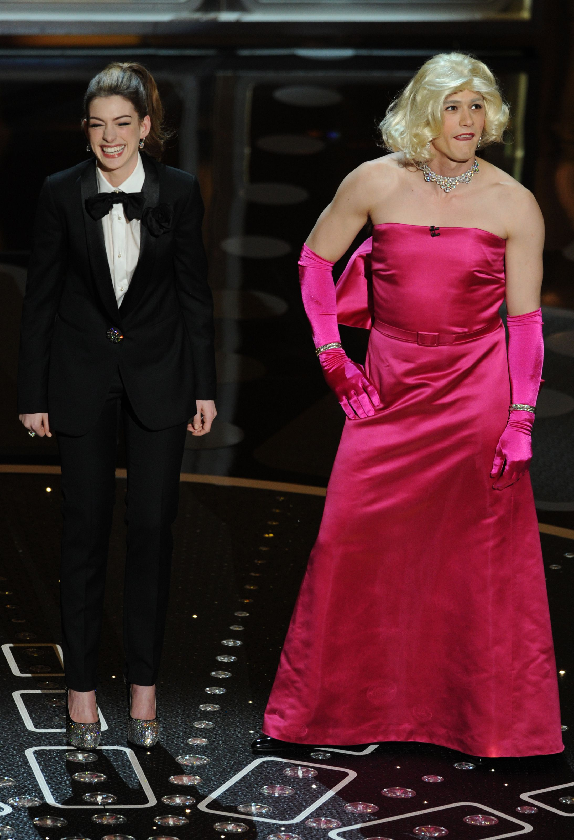 2011: When James Franco and Anne Hathaway hosted. In reversed gender roles, Franco wore a satin pink gown and Hathaway wore a tuxedo to host the 2011 Oscars.