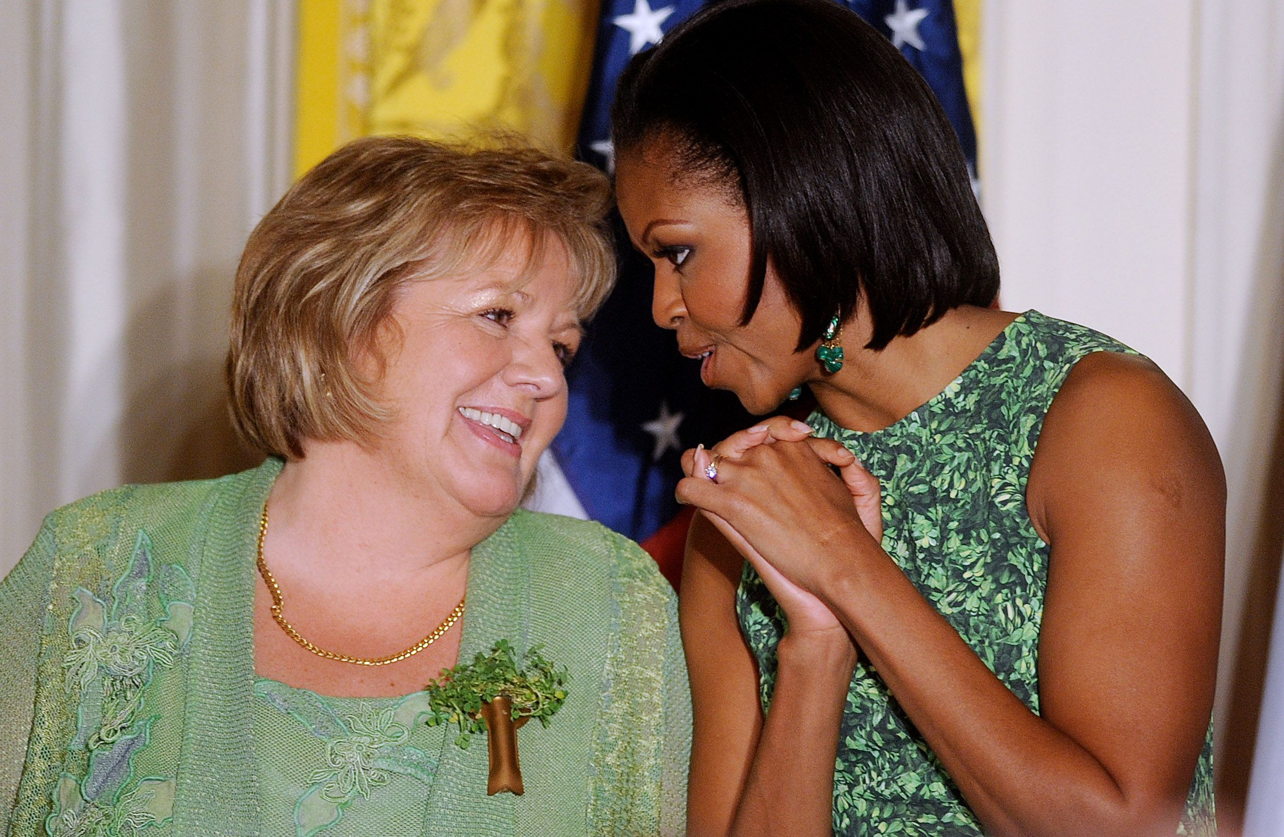 Michelle Obama and wife of Irish Prime Minister Fionnuala O'Kelly attend a St. Patrick's Day reception in the East Room of the White House on March 17, 2011 in Washington, D.C.
