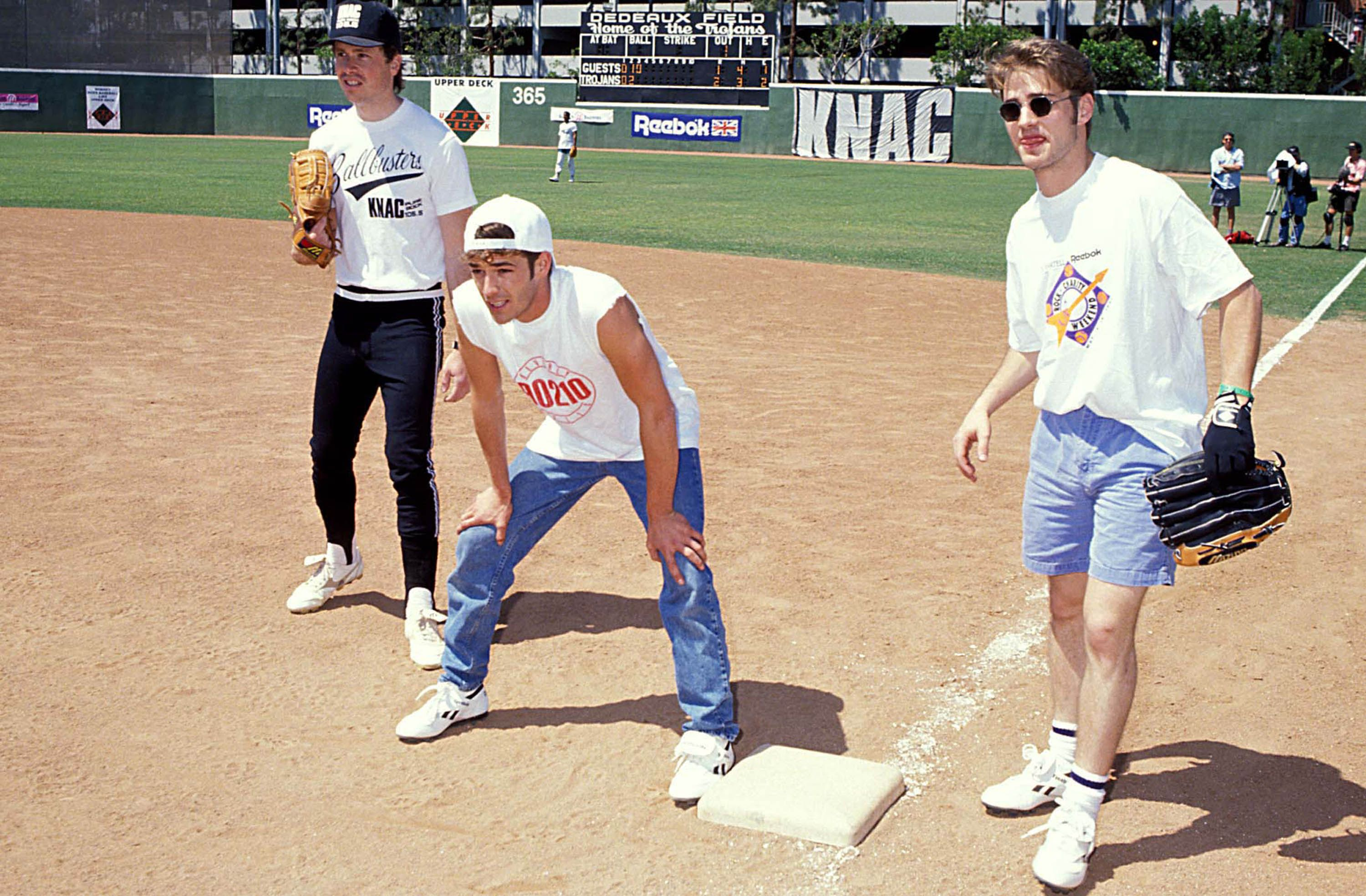 Perry playing softball in 1991.