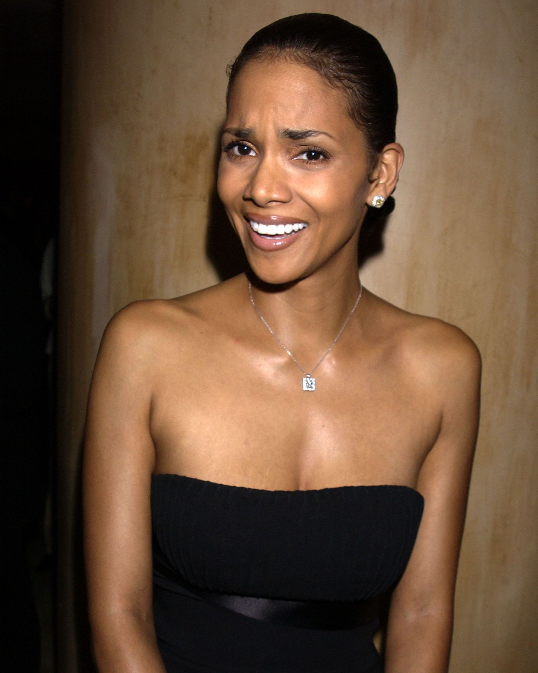 Candidly Beautiful I like to think Halle was caught in a moment of flattery when this photo was taken. She was the honoree at the 2002 Make-A-Wish Foundation Gala.