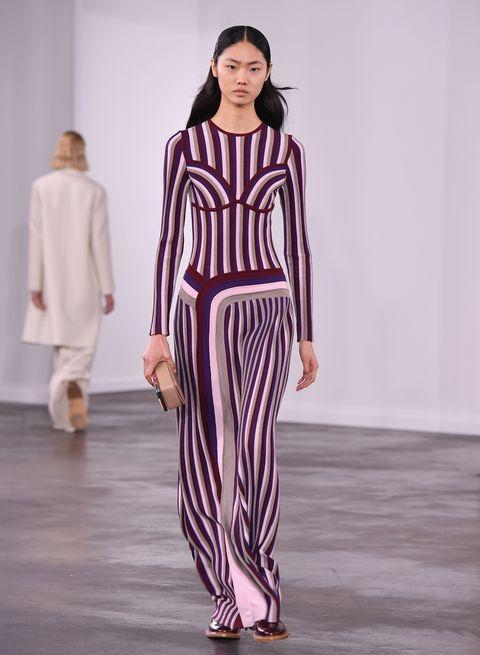 Fashion model, Fashion show, Runway, Fashion, Clothing, Public event, Shoulder, Event, Fashion design, Haute couture,