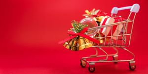 Close-Up Of Shopping Cart Against Red Background