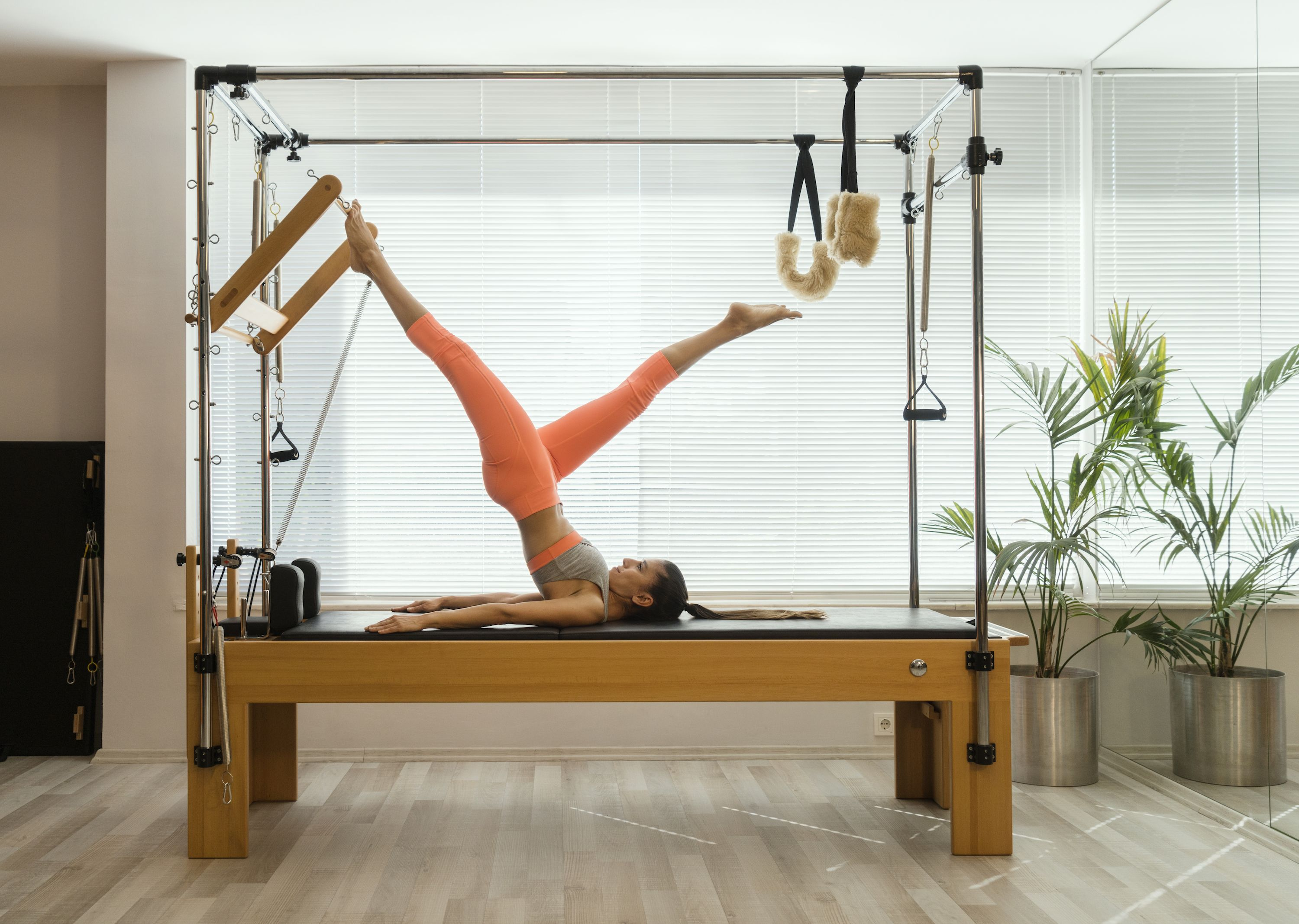 Pilates Reformer is Big News (Again). Here's Why It's So Popular + it's Benefits