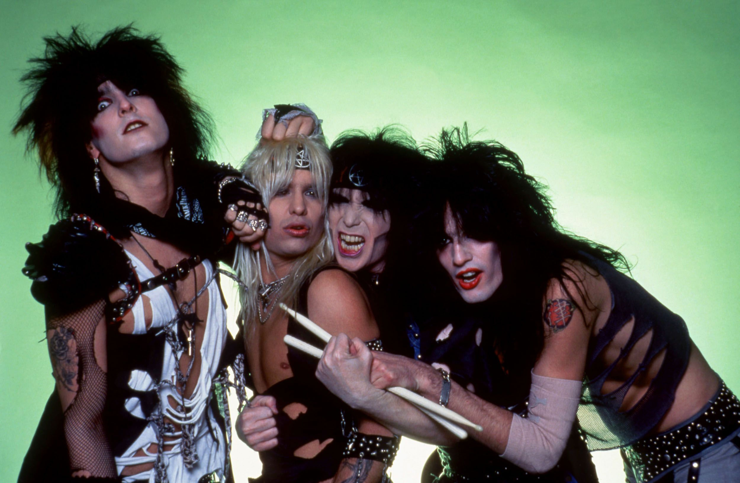 Mötley Crüe pose for a studio portrait during Ozzy Osbourne's Bark at the Moon Tour on March 6, 1984 at Joe Louis Arena in Detroit, Michigan.