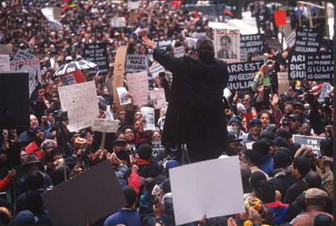 a crowd protesting the shooting of unarmed immigrant amadou diallo