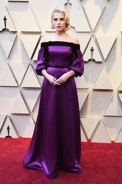 Carpet, Dress, Clothing, Red carpet, Shoulder, Purple, Gown, Flooring, Satin, Strapless dress,