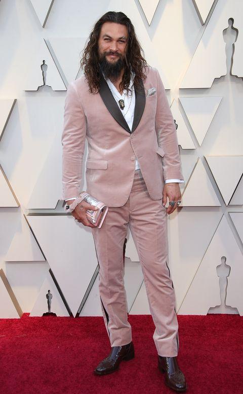Suit, Red carpet, Clothing, Carpet, Pantsuit, Outerwear, Fashion, Formal wear, Blazer, Pink,