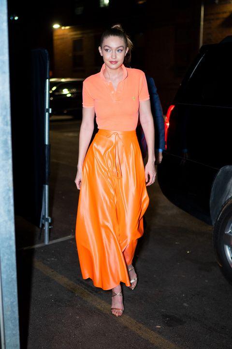 Clothing, Fashion model, Orange, Fashion, Dress, Waist, Haute couture, Fashion show, Fashion design, Formal wear,