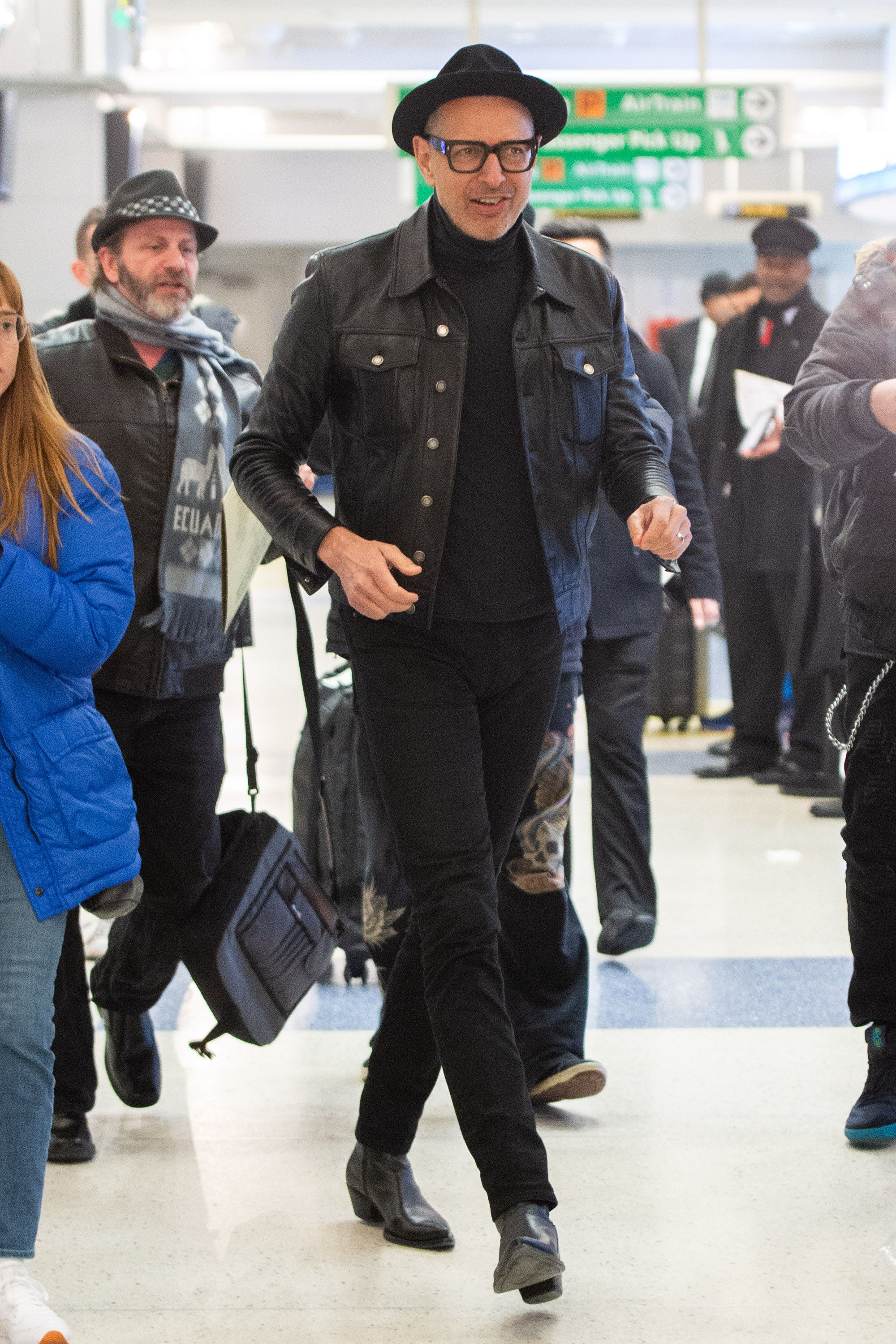 Jeff Goldblum Jeff Goldblum has been making some moves as a style icon as of late. This all-black look is a standout: a turtleneck, trucker, boots, and thick-framed glasses.
