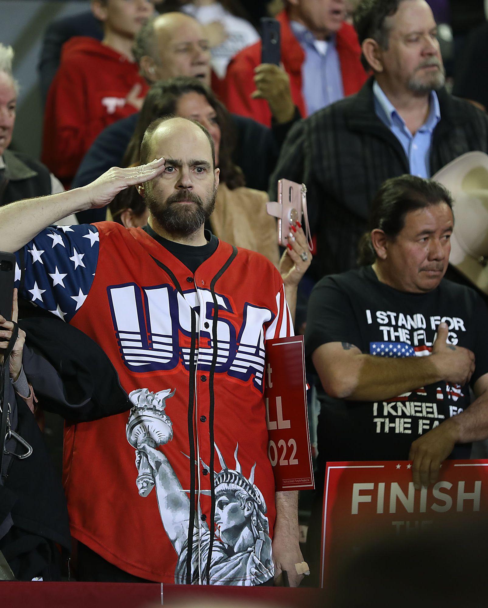 A man at a Trump rally in El Paso salutes.