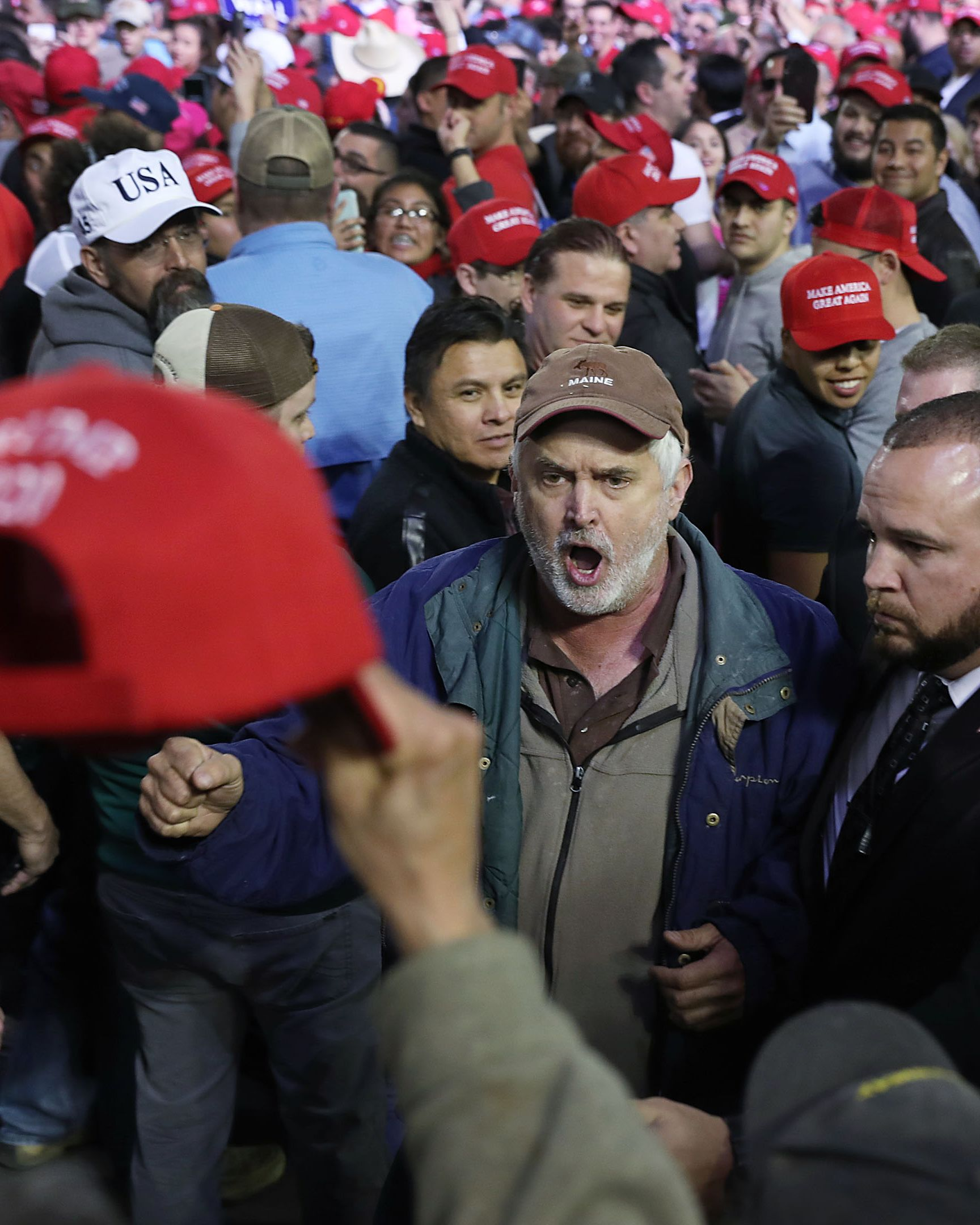 A Trump supporter yells at protesters as they're removed from the rally in El Paso.