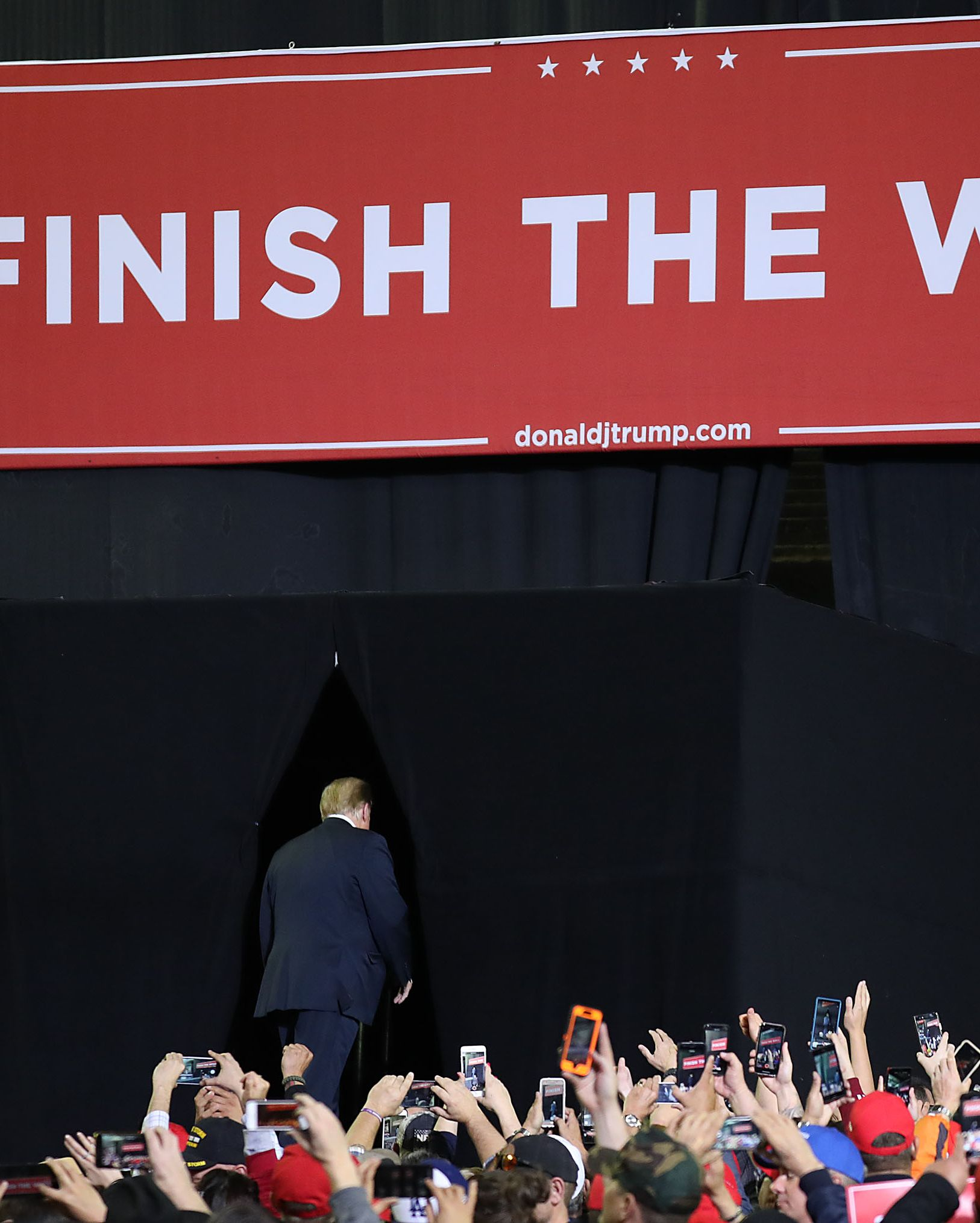 Trump leaves the stage of his rally on Monday.