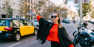 Tourist woman hailing a taxi in Barcelona