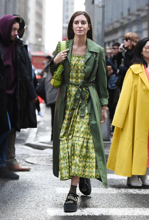 Clothing, Street fashion, Fashion, Outerwear, Yellow, Snapshot, Coat, Fashion model, Footwear, Overcoat,