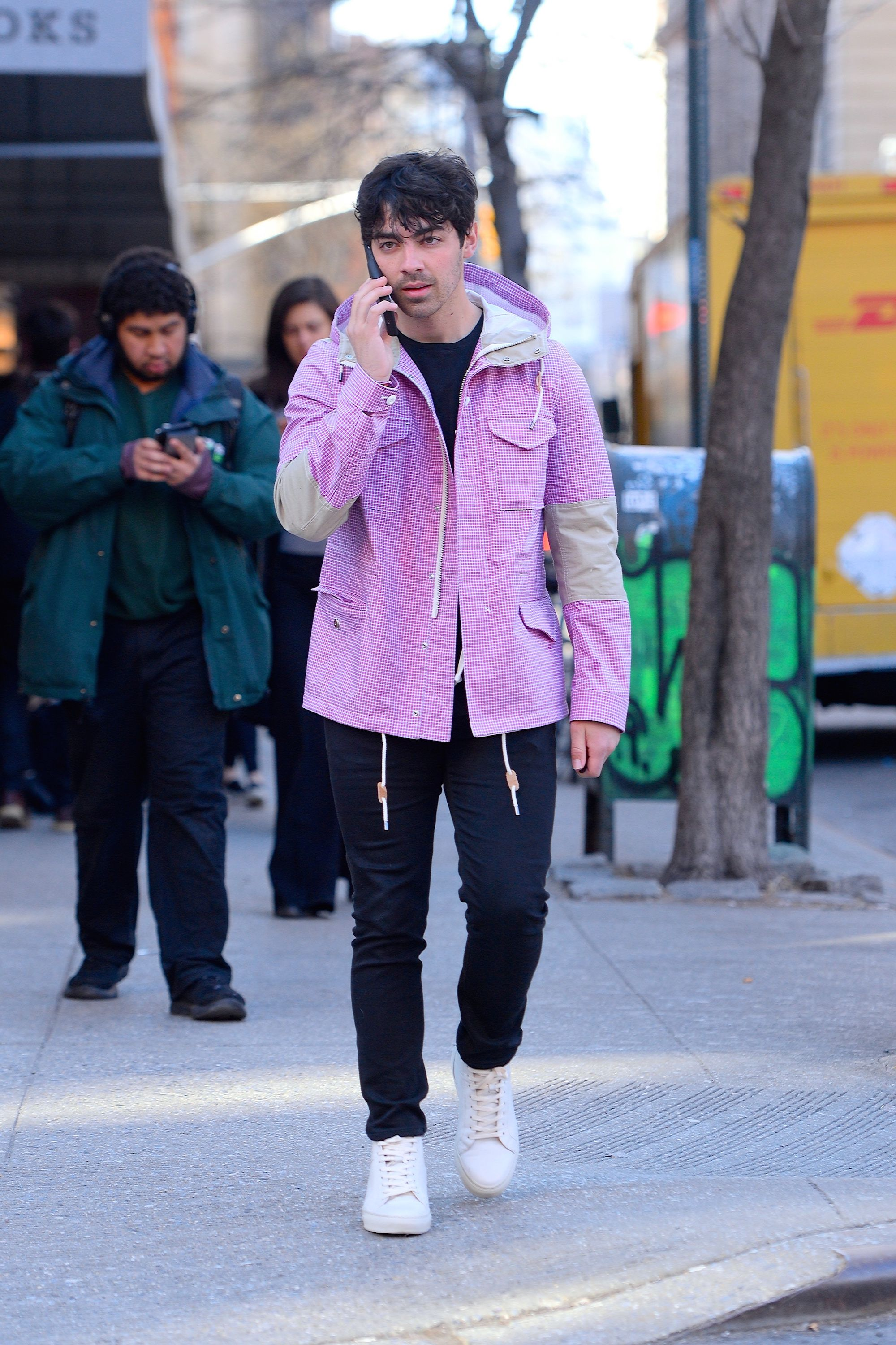 Joe Jonas Statement jackets are the best way to make transitional weather outfits feel fun. And black jeans are the best way to make sure you don't look too out-there.