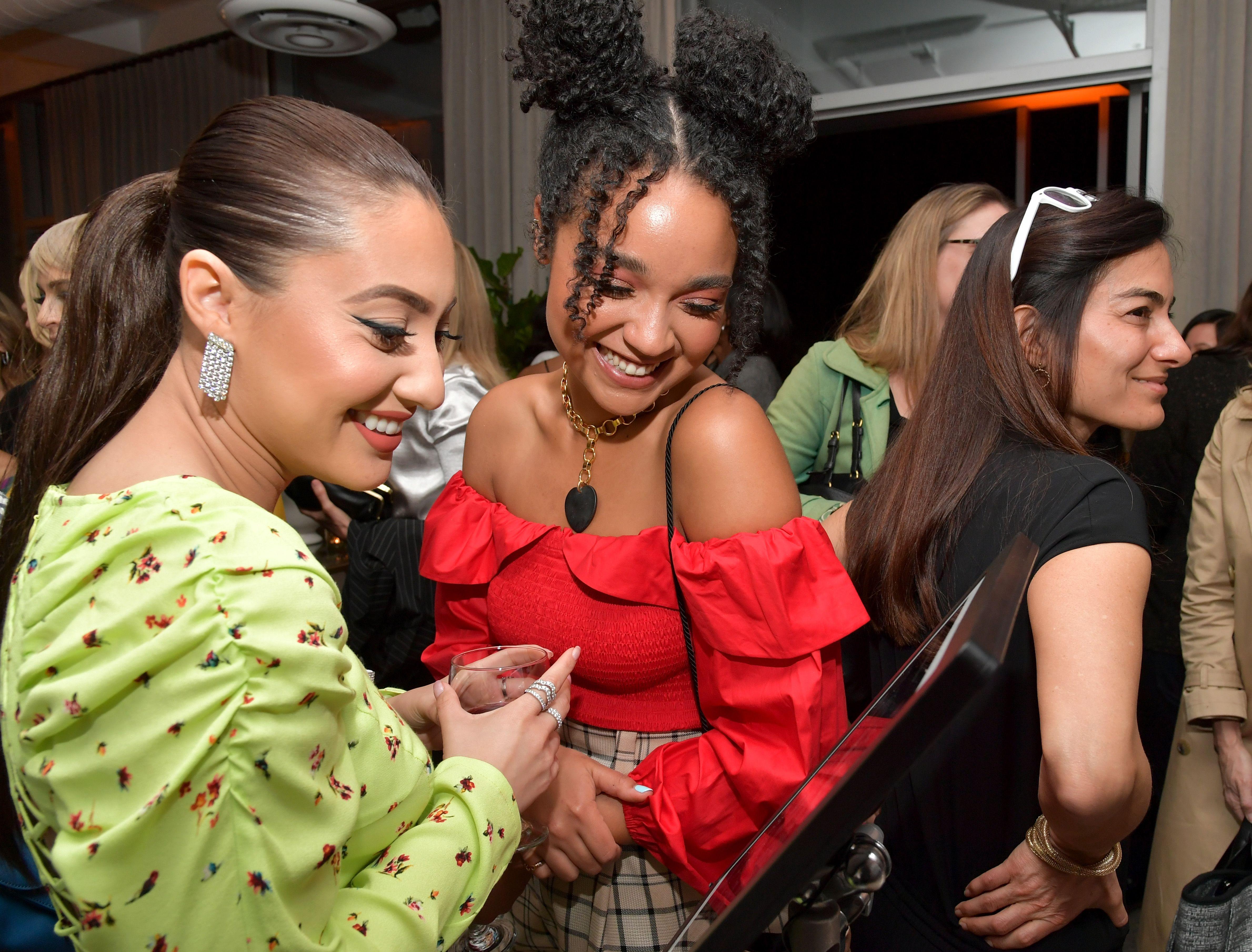Francia Raisa and Aisha Dee.